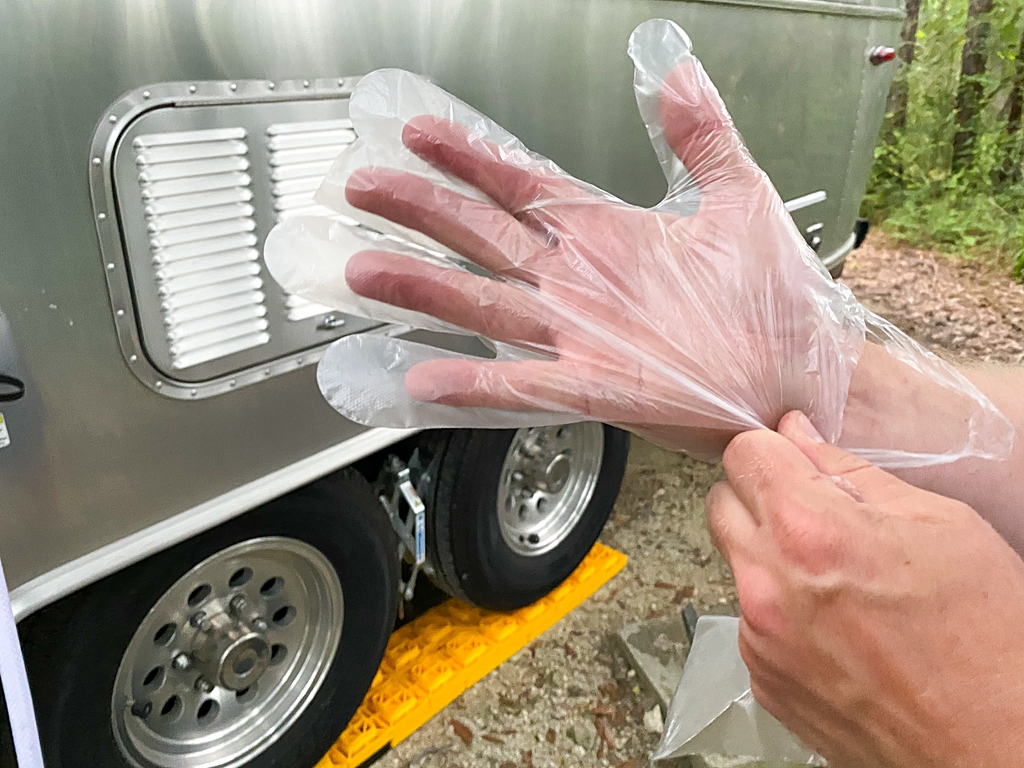 setting up campsite RV connecting sewer hose
