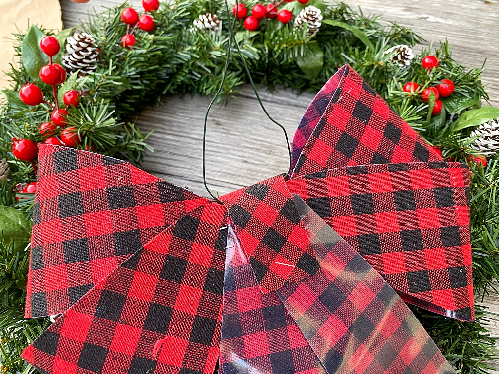 how to add a bow to. a christmas wreath
