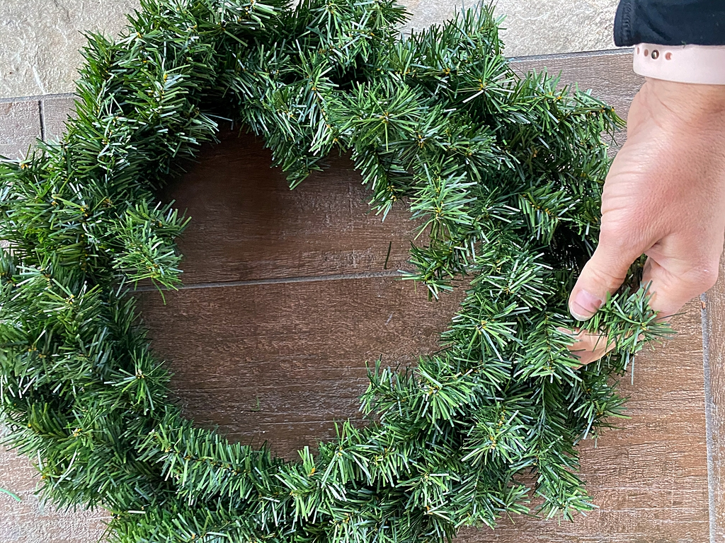 decorating a faux christmas wreath